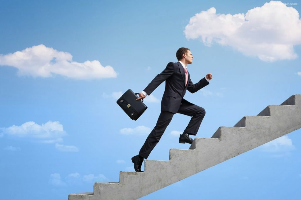 A Success symbol a man on the success Stair